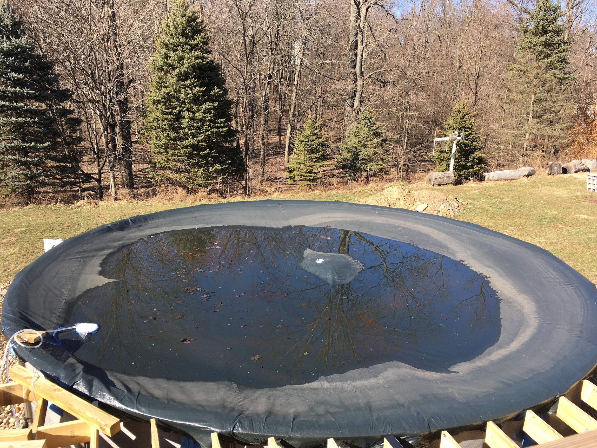 pool cover drained of water with shaker siphon pump